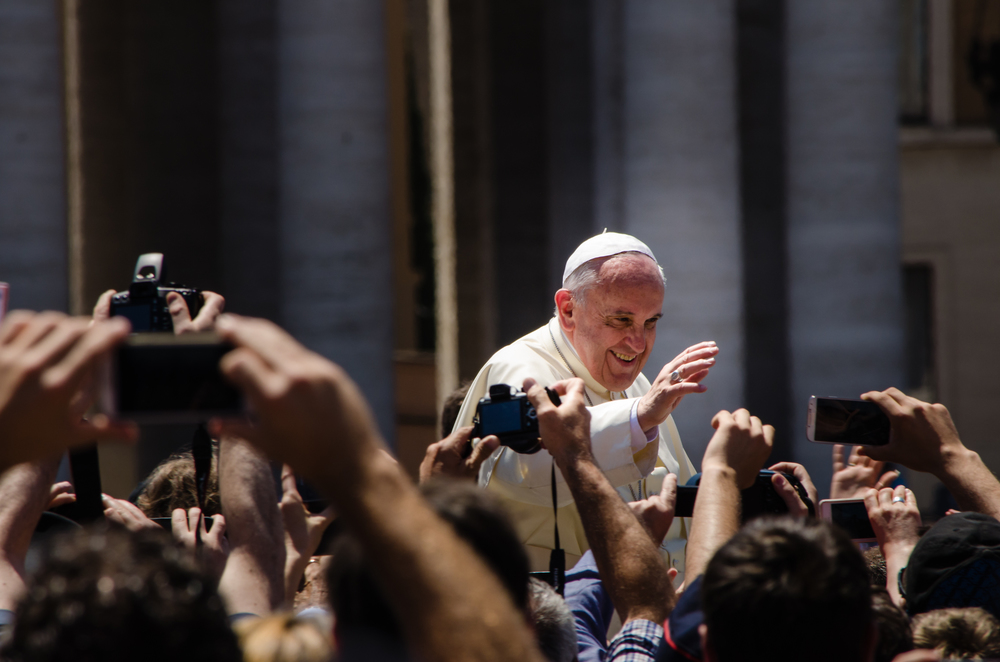 Pope Francis greeting onlookers. Credit: Wikimedia Commons.