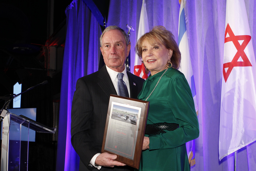 Michael R. Bloomberg presents Barbara Walters with the 2014 AFMDA's Humanitarian Award. Credit: AFMDA