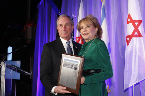 Michael R. Bloomberg presents Barbara Walters with the 2014 AFMDA's Humanitarian Award. Credit: AFMDA