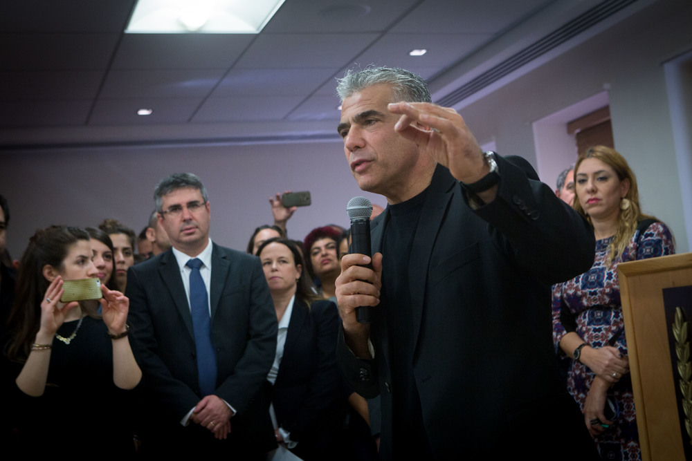 Click photo to download. Caption: On Dec. 4, jettisoned Israeli finance minister Yair Lapid, leader of the Yesh Atid political party, speaks during a farewell party in his honor at the Ministry of Finance in Jerusalem. Lapid and Justice Minister Tzipi Livni were dismissed from Prime Minister Benjamin Netanyahu's coalition on Dec. 2. Credit: Miriam Alster/Flash90.