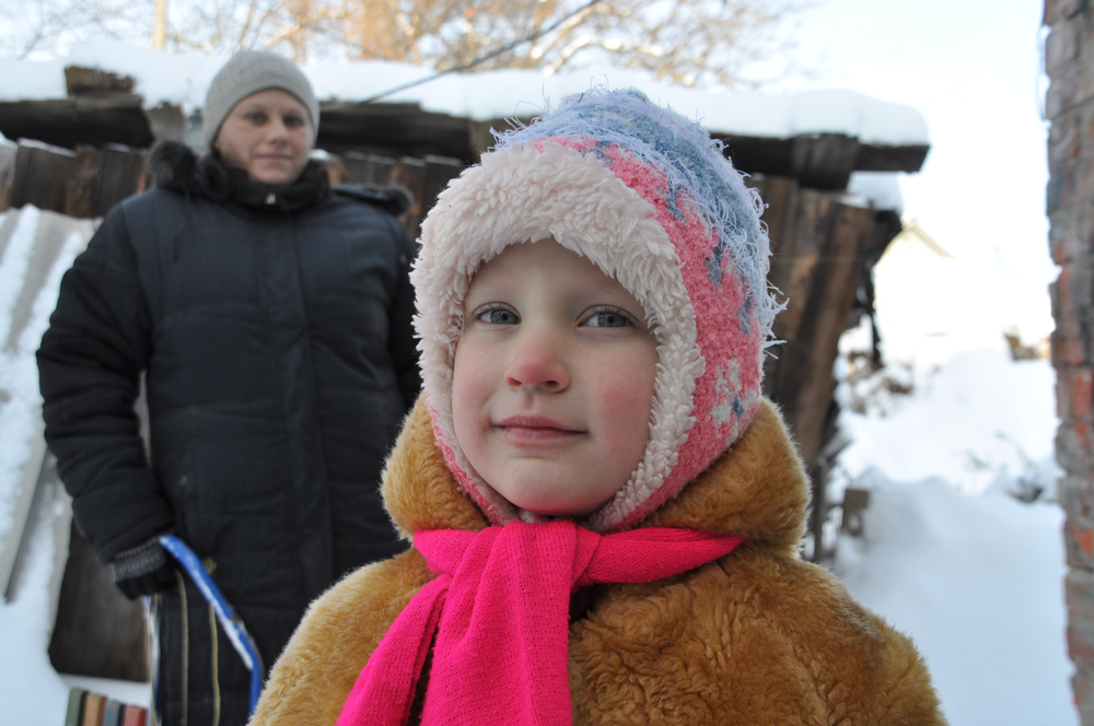 Caption: JDC clients standing outside their home in Poltova, Ukraine.Credit: Sarah Levin.