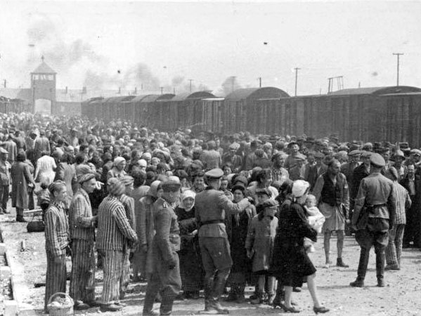 Jewish prisoners being sorted by Nazi guards after arriving at the Auschwitz concentration camp during the Holocaust. Credit: Wikimedia Commons.