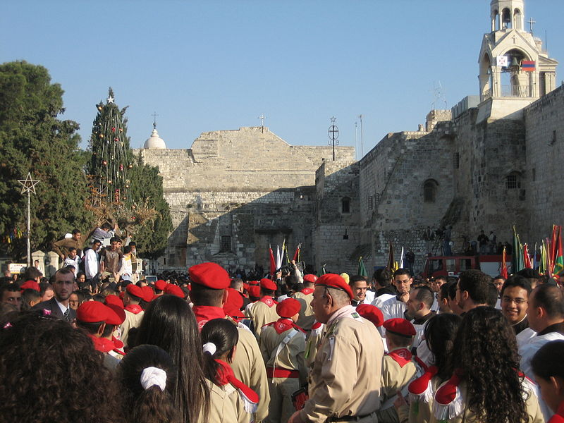 Palestinian Christians pictured outside Bethlehem's Church of the Nativity on Christmas eve in 2006. Credit: Wikimedia Commons.