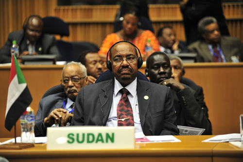Click photo to download. Caption: Omar Hassan al-Bashir (front), the president of Sudan, listens to a speech during the20th session of The New Partnership for Africa's Development in Addis Ababa, Ethiopia, in January2009.Credit: U.S. Navy photo by Mass Communication Specialist 2nd Class Jesse B. Awalt/Released.