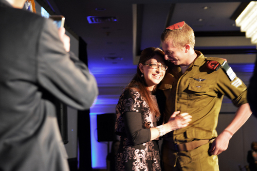 "Click photo to download. Caption: Moshe, a ""lone soldier"" in the Israel Defense Forces, surprises his mother Sharon at the recent New Jersey Chapter gala of Friends of the Israel Defense Forces. Credit: Richard Yumang."