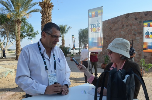 Click photo to download. Caption: Ilan Ben-David—CEO of Chakratec, a producer of electricity storage batteries and an exhibitor at the recent Eilat-Eilot Green Energy 6th International Conference and Exhibition—is pictured being interviewed outside the new Regional Collaboration Center for Research and Development and Renewable Energy near Eilat. Credit: Courtesy of Jewish National Fund.