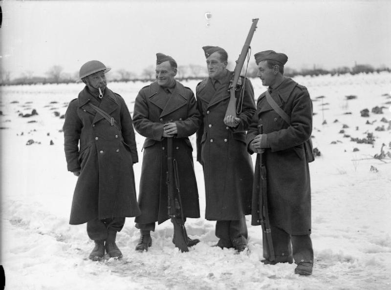 Click photo to download. Caption: Four members of the Auxiliary Military Pioneer Corps (AMPC) at No. 2 Training Centre at Caister, Norfolk, United Kingdom, in 1939. Credit: War Office official photographer.