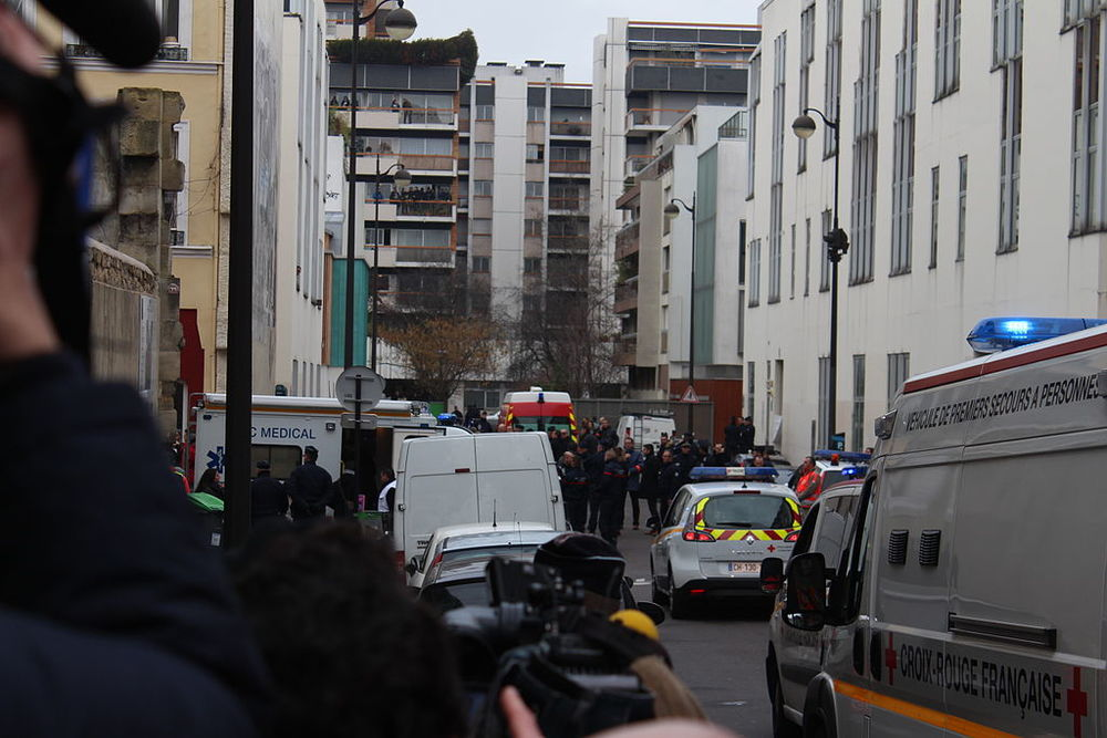 Click photo to download. Caption: The scene of the Jan. 7 Muslim terror attack on the offices of the Charlie Hebdo satirical newspaper in Paris. Credit: Thierry Caro via Wikimedia Commons.