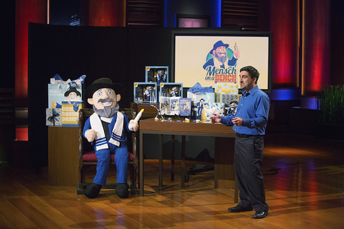 "Click photo to download. Caption: Neal Hoffman presents the ""Mensch on a Bench"" on the ABC program ""Shark Tank."" Credit: Mensch on a Bench."