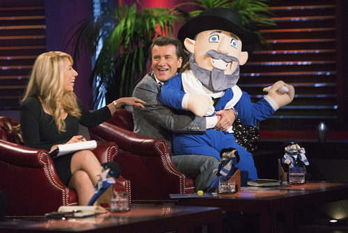 "Click photo to download. Caption: Investors Lori Greiner and Robert Herjavec, pictured with ""Moshe the Mensch,"" offered Neal Hoffman $150,000 for a 30-percent stake in his company. Credit: Mensch on a Bench."