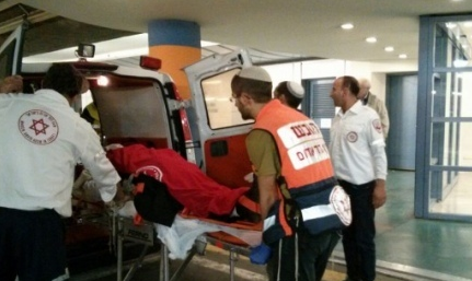 An American yeshiva student who was stabbed Thursday near Jerusalem's Damascus Gate arrives at Shaare Zedek Medical Center. Credit: Magen David Adom.