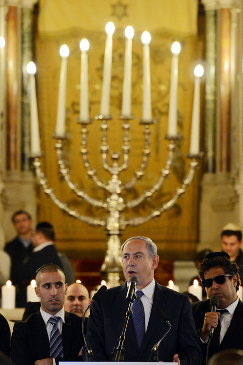 Click photo to download. Caption: On Sunday, Jan. 11, Israeli Prime Minister Benjamin Netanyahu speaks during a ceremony for the victims of last week's Islamist terror attacks in France at Paris's Grand Synagogue. Credit: Haim Zach/GPO.