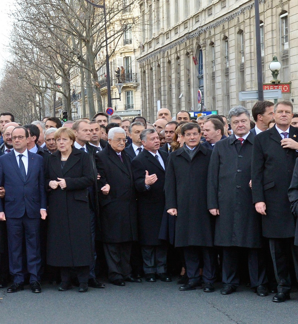 Click photo to download. Caption: Palestinian Authority President Mahmoud Abbas—third from left in the front row, sandwiched between German Chancellor Angela Merkel and Jordan's King Abdullah at the Jan. 11 solidarity march against terrorism in Paris— condemned the attack on the French satirists at  Charlie Hebdo , but recently jailed and tortured a Palestinian satirist. Credit: Haim Zach/GPO.