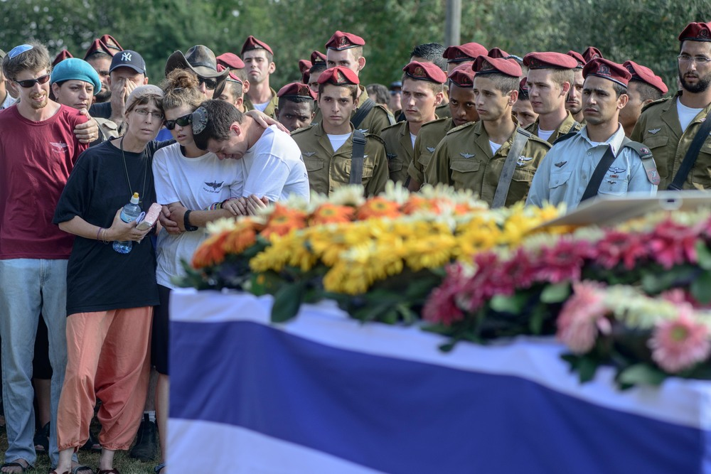 Click photo to download. Caption: Friends and relatives mourn during the funeral ceremony of Shahar Shalev at the Haspin cemetery in northern Israel on Sept. 1, 2014. Shalev, who was injured by an improvised explosive device in the Gazan city of Khan Younis during Operation Protective Edge, became the 72nd and final Israeli casualty of the Gaza war when he died from his wounds. Credit: Flash90.
