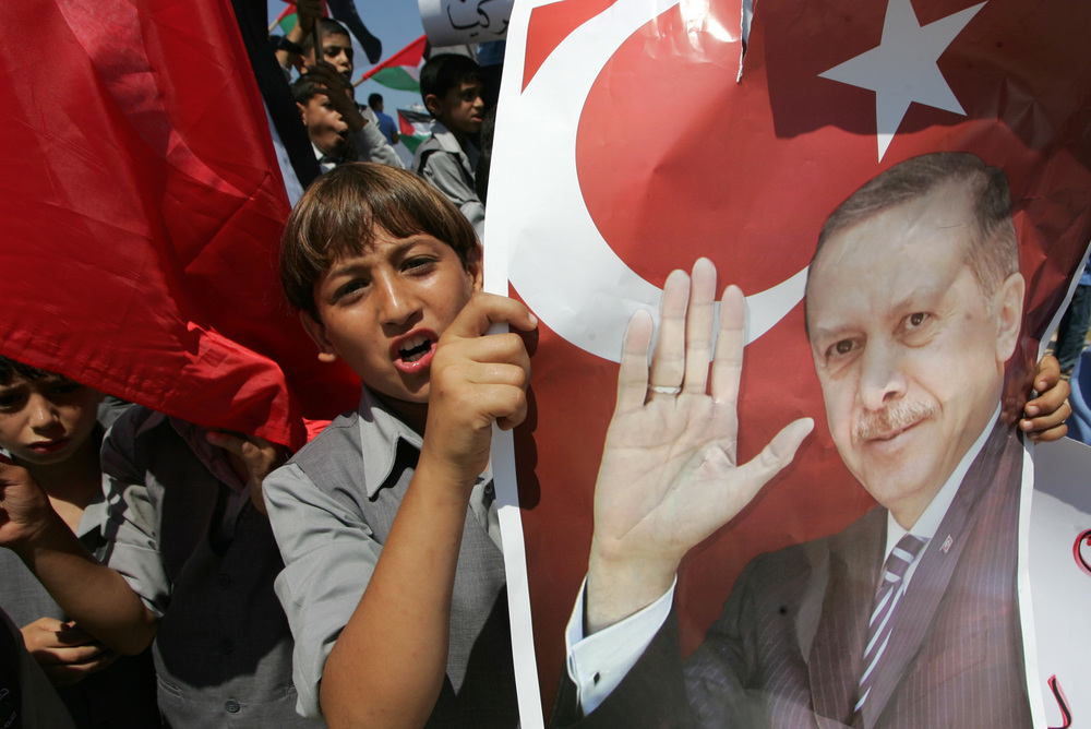 Click photo to download. Caption: In Gaza City on Sept. 13, 2011, Palestinian students hold up pictures of then Turkish prime minister and now President Recep Tayyip Erdogan during a rally that urged Erdogan to visit the Hamas-ruled Gaza Strip. Erdogan's pro-Palestinian and anti-Israel views have been increasingly on display in recent years. Credit: Abed Rahim Khatib/Flash 90.