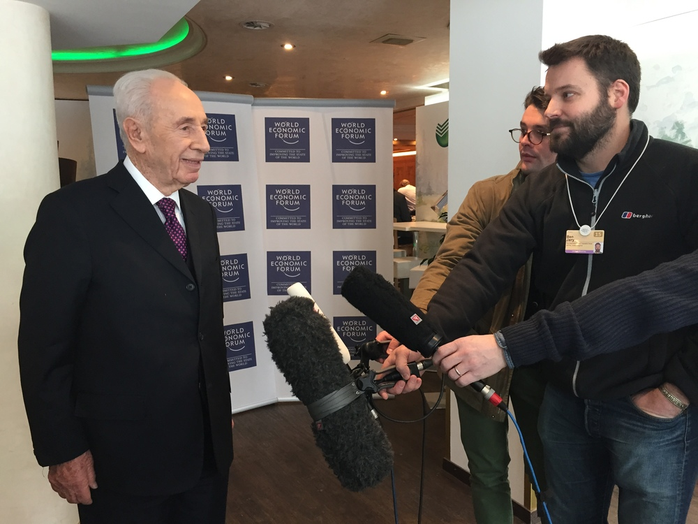 Former Israeli president Shimon Peres, pictured at the World Economic Forum in Switzerland, speaks to reporters about the death of Saudi Arabia's King Abdullah. Credit: Provided photo.