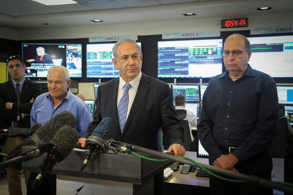 "Prime Minister Benjamin Netanyahu visited the Israel Aerospace Industries center in Lod on January 26, 2015 with  Defense Minister Moshe Yaalon (right), where he called a global agreement with Iran ""dangerous for Israel.""  Credit: Avshalom Shoshani/POOL/Flash90"