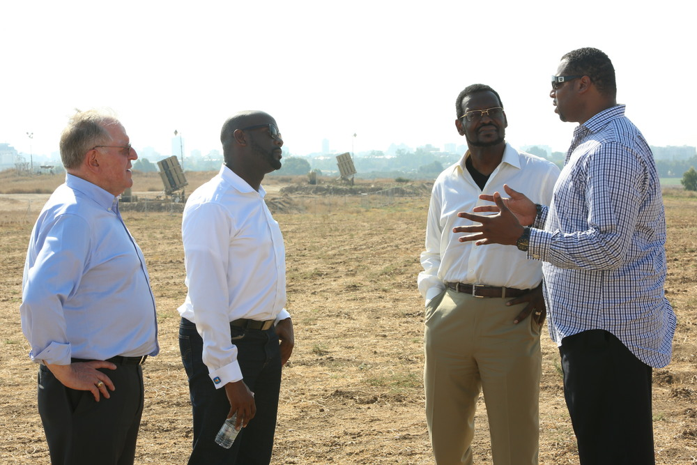 Click photo to download. Caption: Pastors speak near Iron Dome missile defense systems batteries on a Christians United for Israel (CUFI) solidarity mission to Israel during Operation Protective Edge last August. Credit: CUFI.
