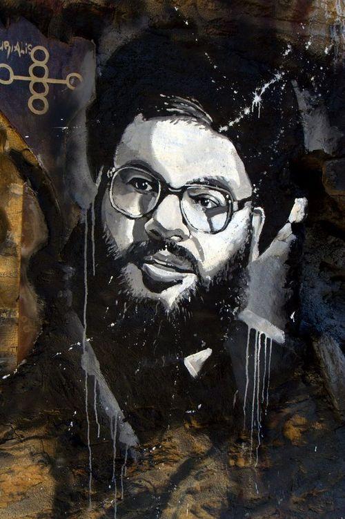 A graffiti image of Hezbollah leader Hassan Nasrallah. Credit: Wikimedia Commons.