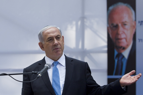 Click photo to download. Caption: On Nov. 5, 2014, Israeli Prime Minister Benjamin Netanyahu speaks at a memorial service in Jerusalem marking 19 years since the assassination of former prime minister Yitzhak Rabin, with a poster of Rabin in the background at right. Netanyahu's supposedly unprecedented step of speaking directly before Congress about the Iranian nuclear threat—rather than working exclusively with the White House on the issue—actually has a historical precedent that was set by Rabin, writes Rafael Medoff. Credit: Miriam Alster/Flash90.