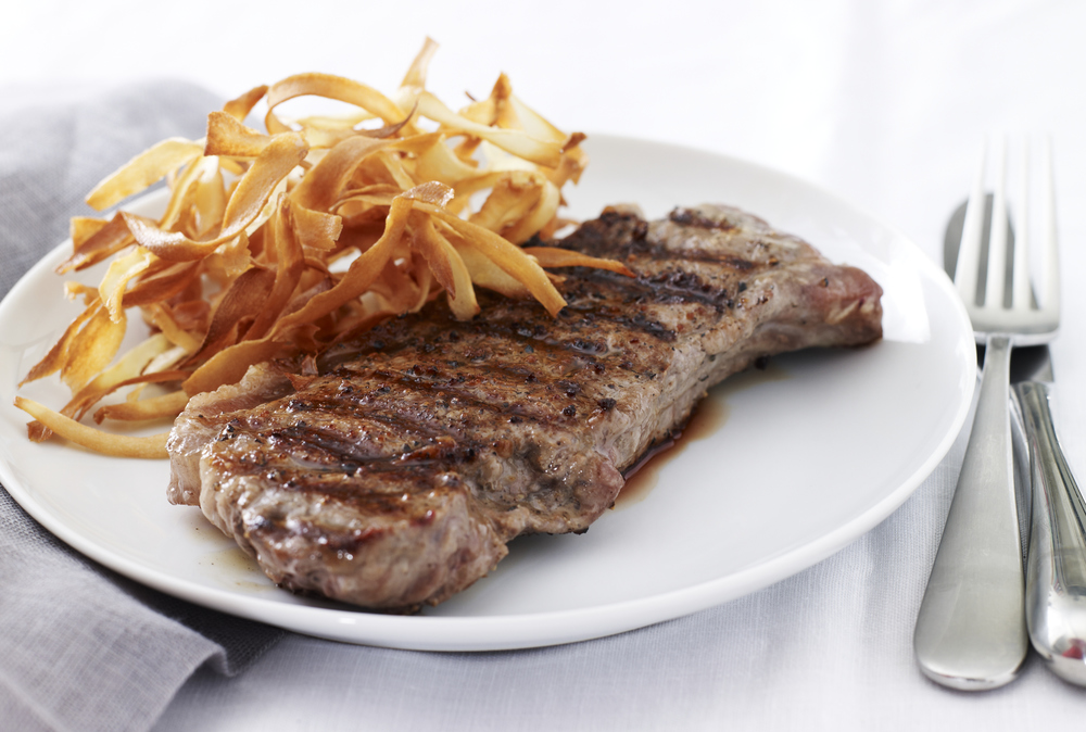 Click photo to download. Caption: Grilled Ribeye with Crispy Parsnips. Credit: Joy of Kosher Magazine with Jaime Geller.