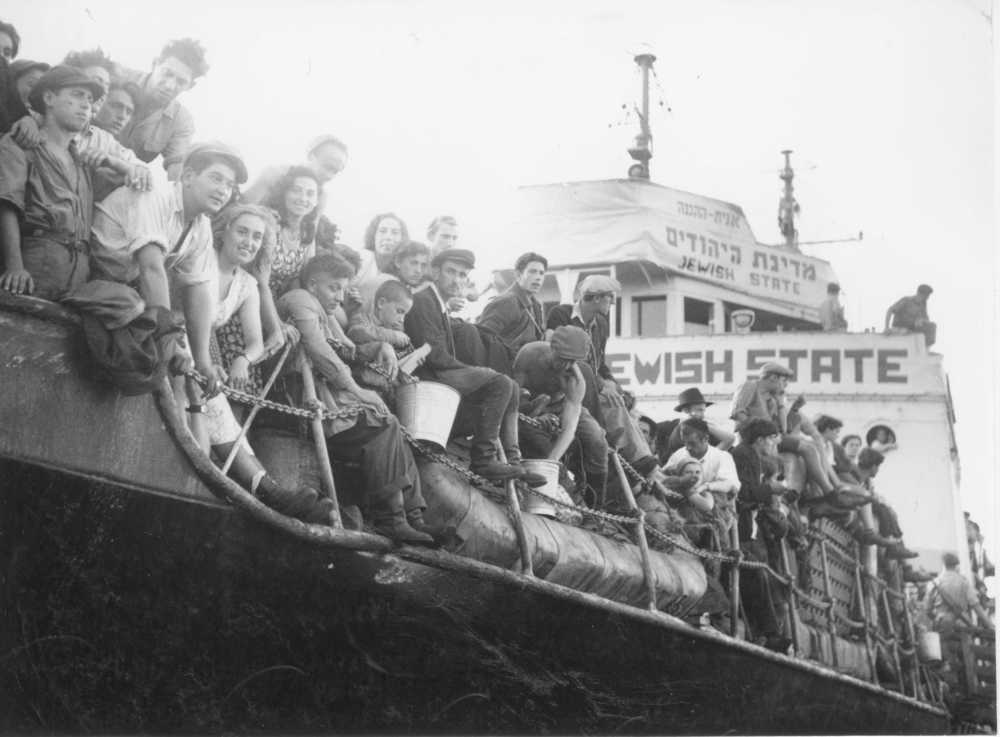Click photo to download. Caption: A boat of new immigrants arrives in pre-state Israel on Oct. 2, 1947. Credit: The Palmach Archive via PikiWiki Israel.