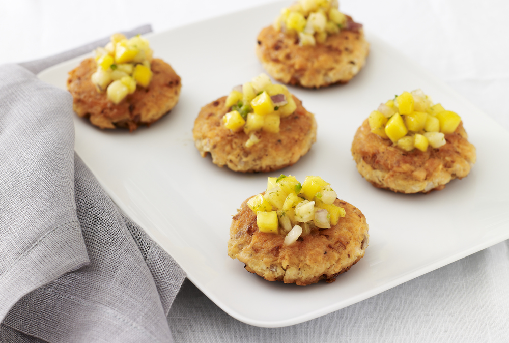 Click photo to download. Caption:   Salmon Cakes with Tropical Fruit Salsa  , part of Jamie Geller's upscale Passover dinner menu. Credit:   Joy of Kosher Magazine   with Jaime Geller.