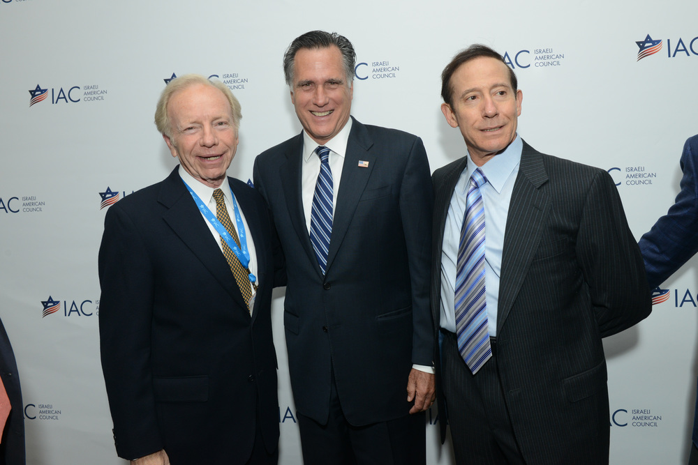 Click photo to download. Caption: From left to right: former Democratic vice presidential candidate Joe Lieberman, Republican presidential candidate Mitt Romney, and Jewish philanthropist Adam Milstein at the Israeli-American Council national conference in Washington in Nov. 2014. Credit: Shahar Azran.