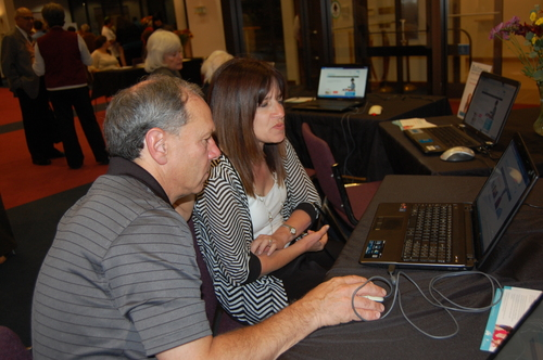 Click photo to download. Caption: At an eventof the Baltimore Jewish Abilities Alliance (BJAA), participants use the BJAA website, which offers a local resource guidefor people with disabilities. Credit: The Associated: Jewish Community Federation of Baltimore.