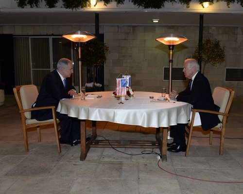 Click photo to download. Caption: U.S. Vice President Joe Biden shares a table with Israeli Prime Minister Benjamin Netanyahu in Jerusalem in January 2013. Biden will be skipping Netanyahu's March 3 address to Congress. Credit: Matty Stern/State Department.