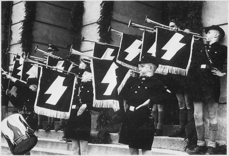 Hitler Youth Hour of Commemoration in front of the Town Hall in Tomaszow, Poland during German-Nazi occupation, May 11, 1941. Recently a Holocaust memorial organization discovered a drum made from a Torah scroll that was used by members of the Hitler Youth. Credit: U.S. National Archives and Records Administration via Wikimedia Commons.