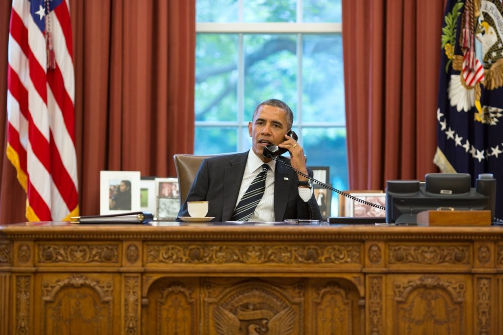 Click photo to download. Caption: From the Oval Office, U.S. President Barack Obama speaks on the phone with Iranian President Hassan Rouhani on Sept. 27, 2013. Credit: Pete Souza/White House.
