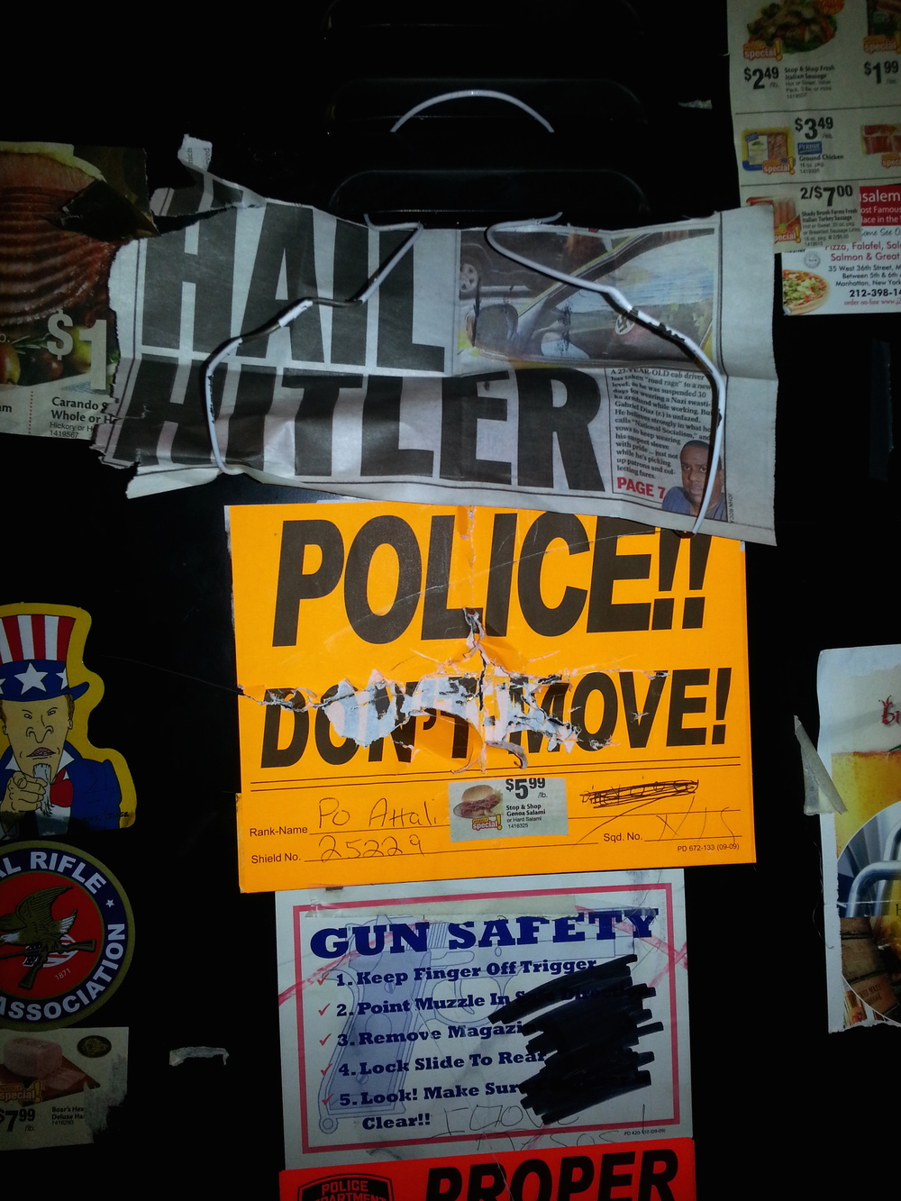 "Click photo to download. Caption: The anti-Semitic vandalism on the locker (pictured here) of former New York Police Department officer David Attali included swastikas, the words ""dirty Jew,"" pictures of ham or bacon (which are prohibited under Jewish dietary laws), and newspaper clippings that read, ""Hail Hitler."" Credit: Provided photo."