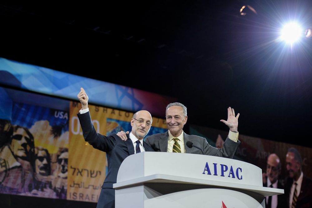 U.S. Sen. Chuck Schumer (D-N.Y., at right) with Bob Cohen, the president of the American Israel Public Affairs Committee (AIPAC), on the stage of the 2014 AIPAC conference last March. Credit: AIPAC.