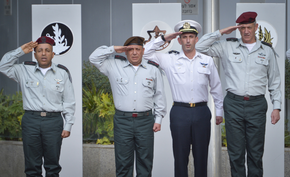 Click photo to download. Caption: At the pictured ceremony in Tel Aviv on Monday, Gadi Eizenkot (second from left) succeeded Benny Gantz (far right) as chief of staff of the Israel Defense Forces. Credit: Flash90.