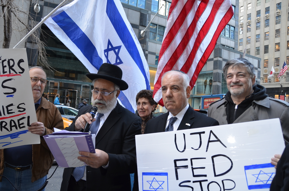 "Click photo to download. Caption: On April 8, 2014, a rally in New York City against what protesters called the inclusion of ""pro-BDS (Boycott, Divestment and Sanctions) groups"" in the annual Celebrate Israel Parade. Holding the microphone is Israeli Member of Knesset Nissim Ze'ev (Shas). Credit: Maxine Dovere."