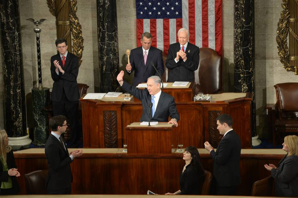 Click photo to download. Caption: Israeli Prime Minister Benjamin Netanyahu waives to the crowd during his address to a joint session of Congress on Tuesday. Credit: Amos Ben Gershom/GPO.