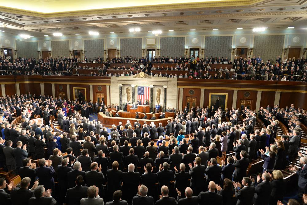 Click photo to download. Caption: Federal legislators applaud Israeli Prime Minister Benjamin Netanyahu during his speech to a joint session of Congress on Tuesday. Credit: Amos Ben Gershom/GPO.