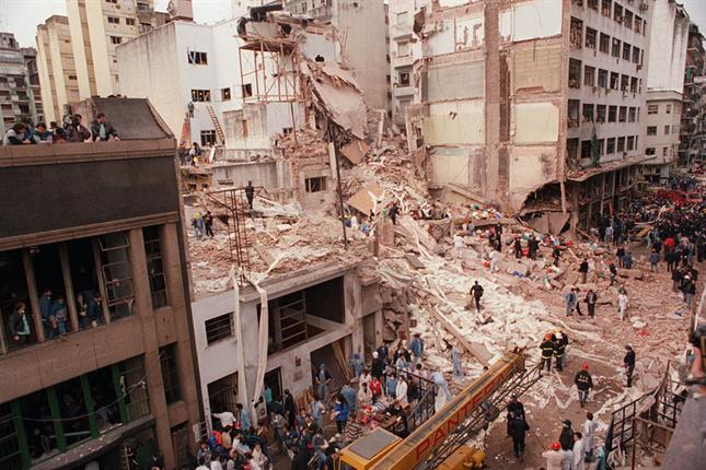 Click photo to download. Caption: The remains of the AMIA Jewish center in Buenos Aires following the bombing there in 1994. Iran is believed to have been behind that attack, which killed 85 people and injured 300. Credit: Wikimedia Commons.