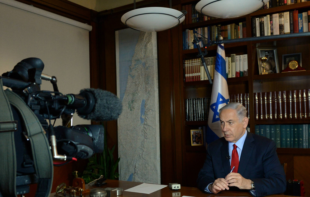 Click photo to download. Caption: Israeli Prime Minister Benjamin Netanyahu gives a television interview from his office in Jerusalem on March 5, 2015. Credit: Haim Zach/GPO.
