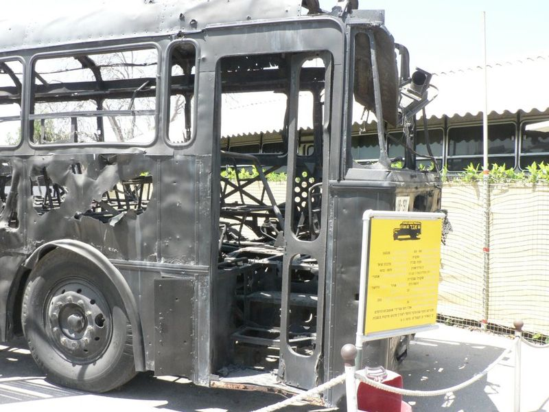 The charred remains of the Israeli bus attacked by Palestinian terrorists in the 1978 Coastal Road massacre. Credit: Wikimedia Commons.