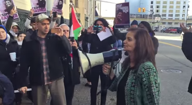 Holding the megaphone is convicted Palestinian terrorist Rasmieh Yousef Odeh. Credit: YouTube.