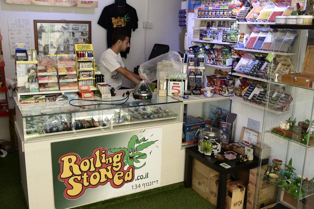 "Click photo to download. Caption: Inside ""Rolling Stoned,"" a Tel Aviv-based smoke shop that offers Israel's largest variety of smoking and vaporizing paraphernalia for medical marijuana and tobacco. Credit: Tomer Neuberg/Flash90."