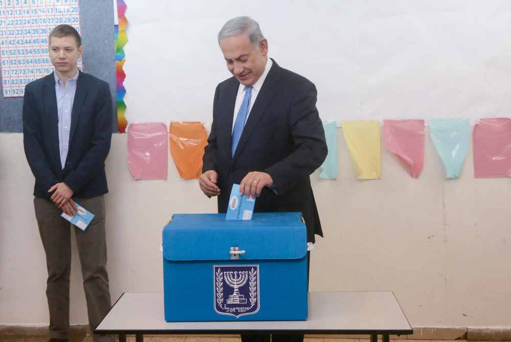 Click photo to download. Caption: Israeli Prime Minister Benjamin Netanyahu votes on Tuesday. Credit: Marc Israel Sellem/POOL/Flash90.