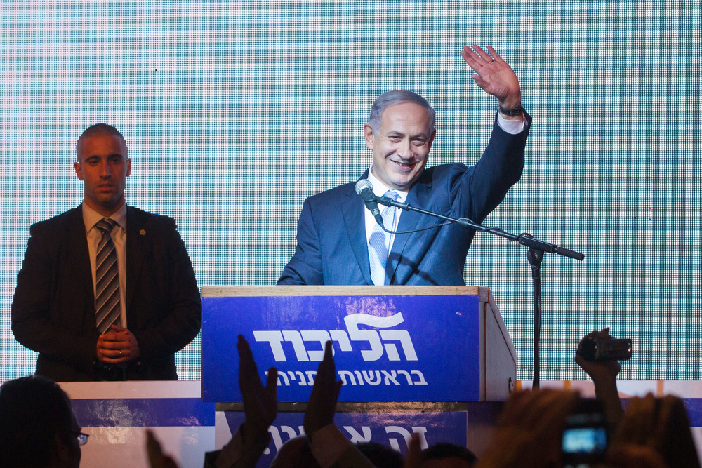 Israeli Prime Minister Benjamin Netanyahu waves to supporters at the Likud party headquarters in Tel Aviv on March 17 after Israeli election exit polls were published. The next day, official election results confirmed a decisive victory for Netanyahu and Likud. Credit: Miriam Alster/Flash90.