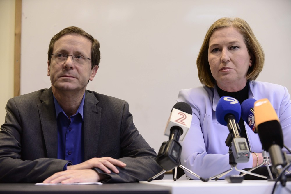Click photo to download. Caption: Zionist Union party leaders Isaac Herzog and Tzipi Livni are pictured at a press conference in Tel Aviv on March 18, when official Israeli election results revealed that they had been decisively defeated by Prime Minister Benjamin Netanyahu's Likud party. While two of the previous night's three television exit polls had Zionist Union and Likud tied at 27 Knesset seats, Likud would ultimately prevail with a comfortable 30-24 advantage. Credit: Tomer Neuberg/Flash90.