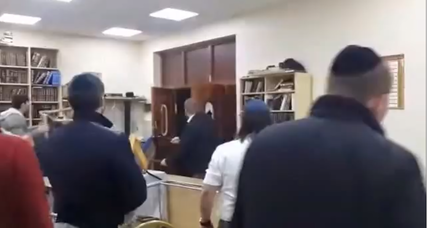 A group of Jewish worshippers at a London synagogue had to ward off a gang of assailants who vandalized the synagogue. Credit: Screenshot from the YouTube video of the attack.