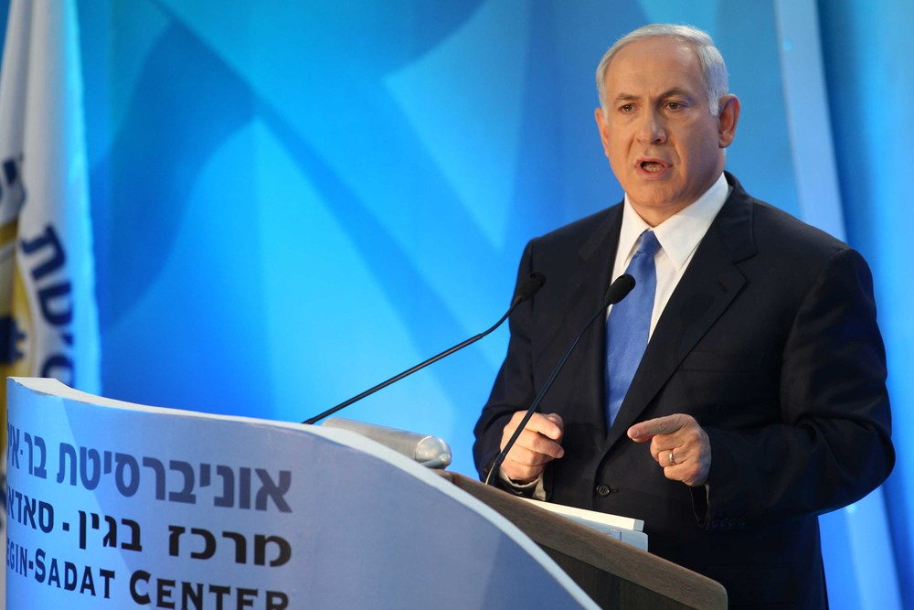Click photo to download. Caption: Israeli Prime Minister Benjamin Netanyahu delivers a speech in which he laid out his peace policy at Bar-Ilan University in Ramat Gan, near Tel Aviv, on June 14, 2009. Six year later, that speech has been the source of fresh debate following Netanyahu's pre-election comments that his government would not support the establishment of a Palestinian state. Credit: Michael Kramer/Flash90.