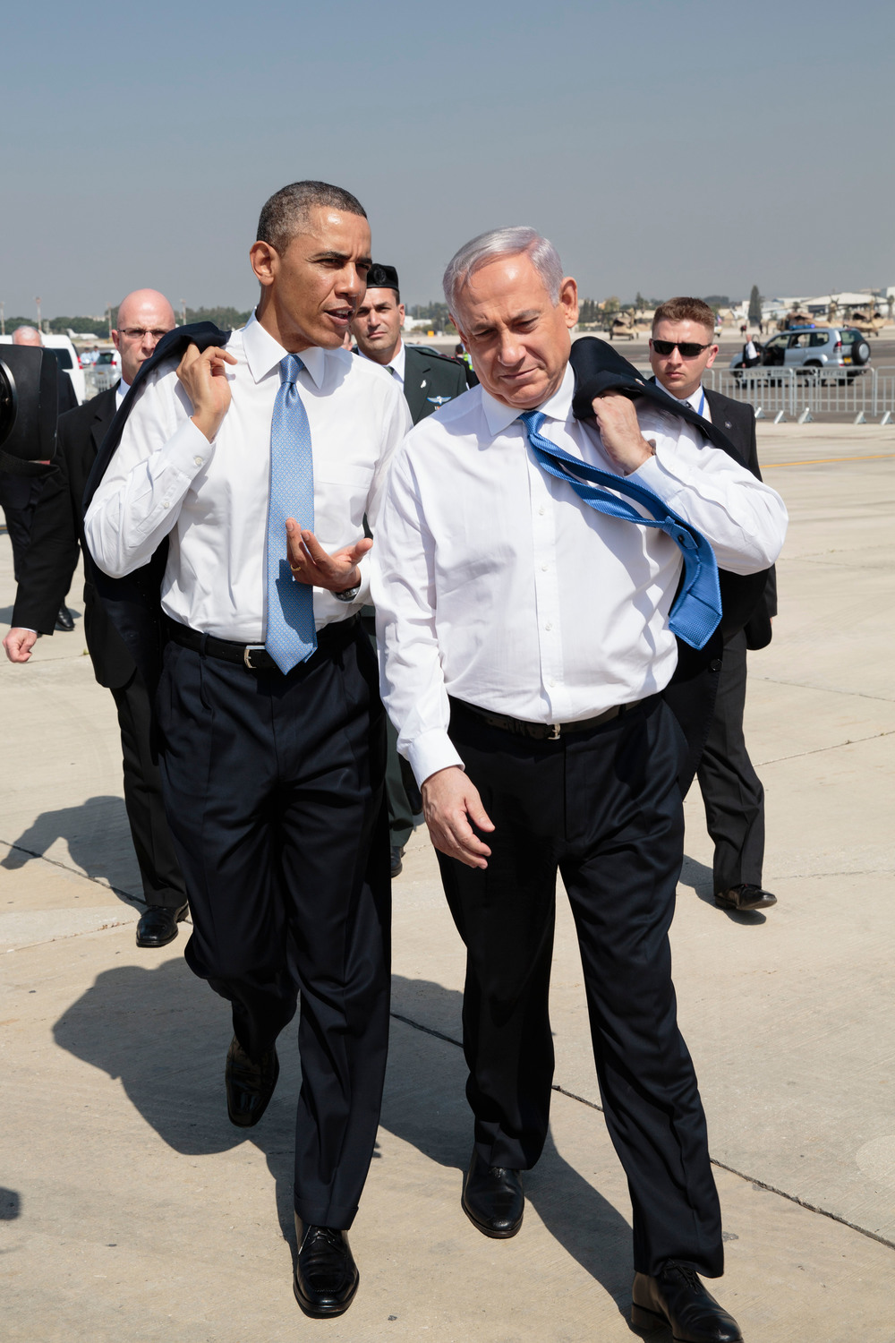 Click photo to download. Caption: U.S. President Barack Obama (left) speaks with Israeli Prime Minister Benjamin Netanyahu as they walk across the tarmac at Ben Gurion International Airport in Tel Aviv on March 20, 2013. Credit: Pete Souza/White House.