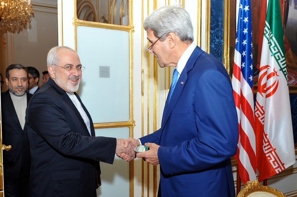 Click photo to download. Caption: U.S. Secretary of State John Kerry (right) shakes hands with Iranian Foreign Minister Mohammad Javad Zarif as he arrives at a hotel in Vienna, Austria, on July 14, 2014, for a day of meetings about Iran's nuclear program. Credit: U.S. State Department.